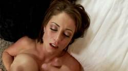 Rubbing Her Massive Tits